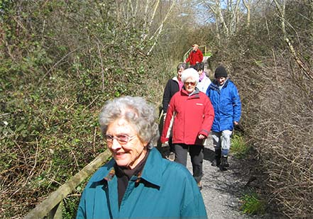 Photo of walkers strolling down from Millenium green on a sunny March morning.